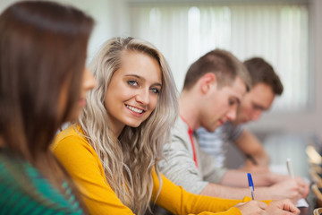 Blonde happy student looking at camera