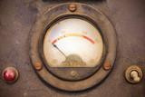 Vintage dusty volt meter in a metal casing poster