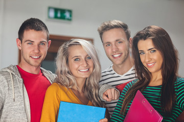 Smiling casual students looking at camera