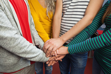 Close up of students holding hands together