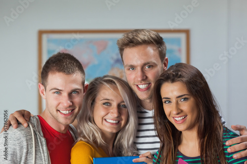 Cheerful casual students looking at camera