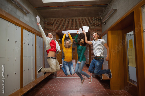 Excited casual students jumping in the air