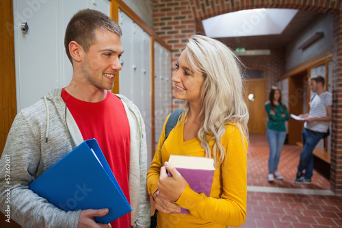 Two smiling students chatting