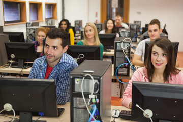 Students listening in their computer class