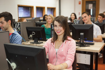Happy students listening in their computer class