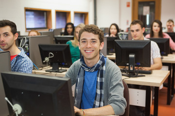 Cheerful students listening in their computer class