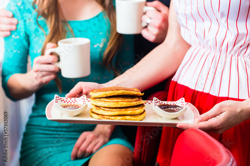 People in diner or restaurant having pancakes