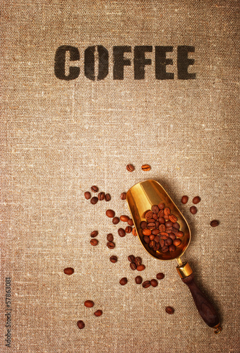Bag with the word coffee and scoop with coffee beans