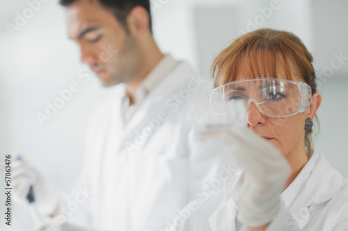 Team of serious scientists at work