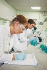 Profile view of three scientists working in a laboratory