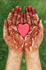 Heart shape in henna hands