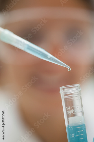 Extreme close up of pipette and test tube