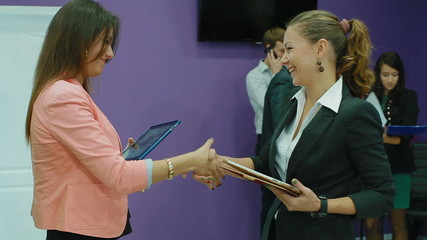 work environment in the office.  Women's handshake