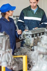 Trainee asking instructor about engine
