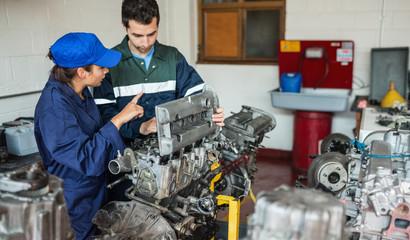 Instructor explaining engine to trainee