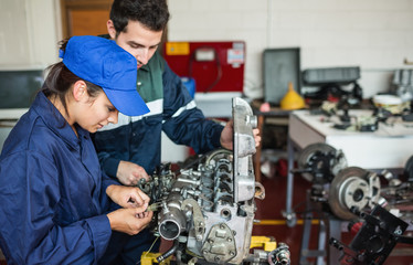 Focused trainee and instructor checking engine