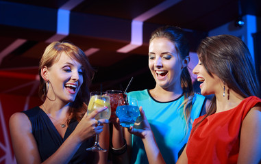 Young female friends celebrating in a nightclub