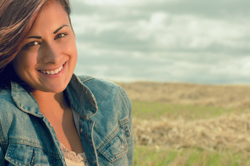 Close up portrait of beautiful smiling woman at cereal field