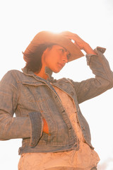 Woman in hat against the sunny sky