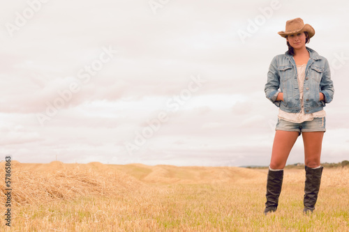 Portrait of a woman in hat at cereal field