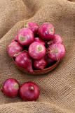 Red onions in a wooden bowl