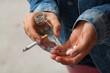 Girl holding vodka,pills and cigarettes