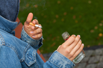 Boy with vodka and cigarette