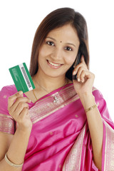 Young Indian woman talking on cellphone