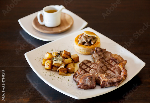 The t - bone steak  grilled on plate.