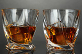 Glasses of whiskey, on dark background
