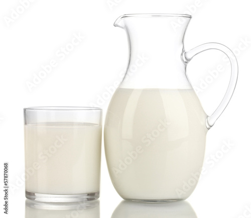 Milk in jug and glass isolated on white