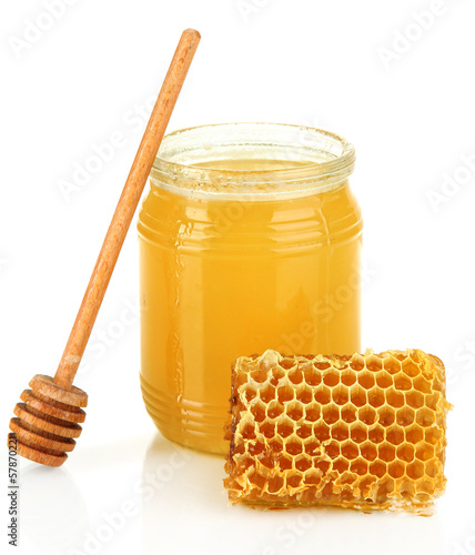 Sweet honeycomb and bank with honey isolated on white