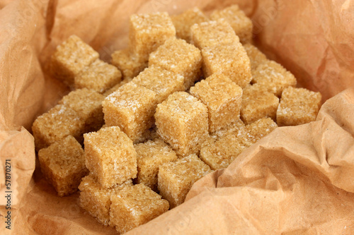 Brown sugar in paper close-up