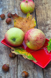 Ripe,sweet apple autumn harvest and fallen leaves