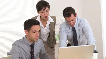 Multi-ethnic businessteam working hard at desk