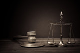 Law scales, judge gavel on table. Symbol of justice