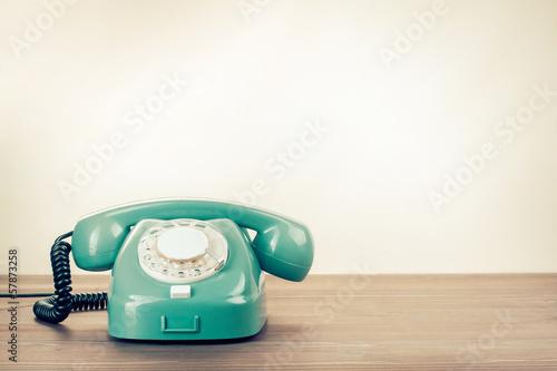 Leinwanddruck Bild Retro rotary telephone on wood table