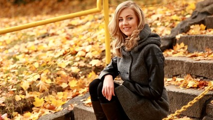 Portrait of beautiful blond woman in park