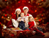 Christmas family of four persons happy smiling over red backgrou