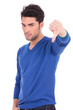 man making the thumbs down negative hand sign
