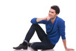 pensive young man sitting