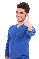 smiling man making the ok thumbs up sign