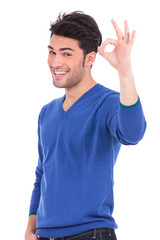 smiling casual man making the ok hand gesture
