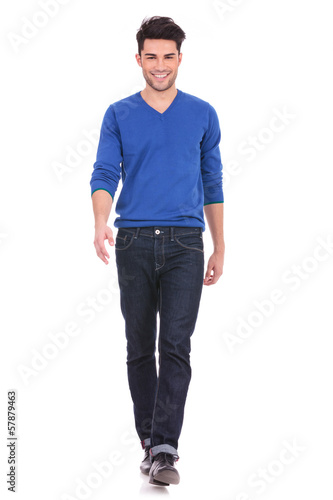 young man walking forwards towards the camera