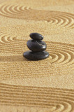 Japanese zen garden with stacked stones in sand