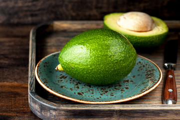 Avocado on a wooden tray vintage