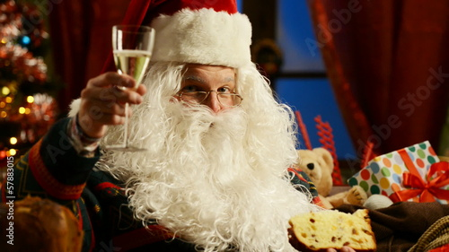 Santa Claus celebrating with champagne