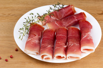 fresh slices of jamon on a plate