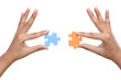Hands with two different jigsaw puzzle pieces