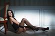 Sexy brunette model sitting on the floor